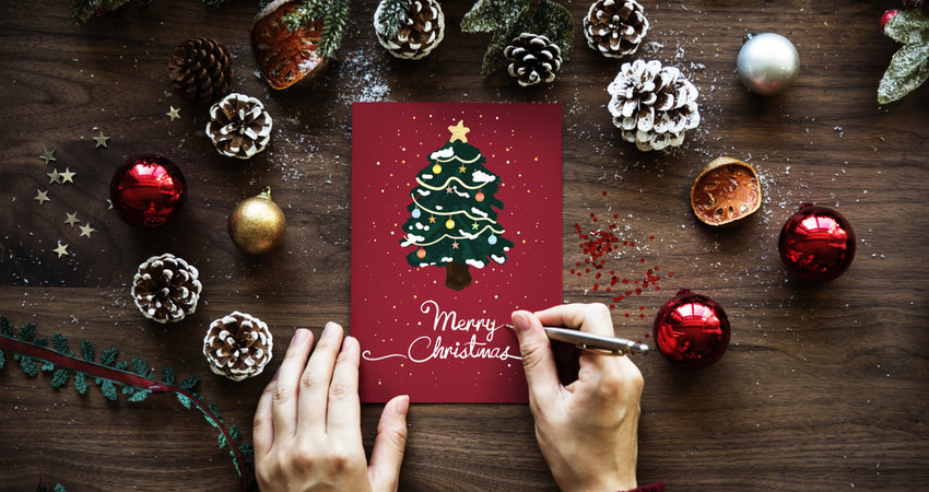 Person making a christmas card